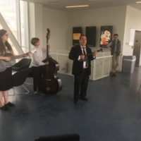 Jerry Grcevich performing with Kathy and Angela White
